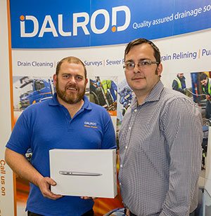 ark Cox presenting Richard Wheatley of Dalrod with a Macbook Air.
